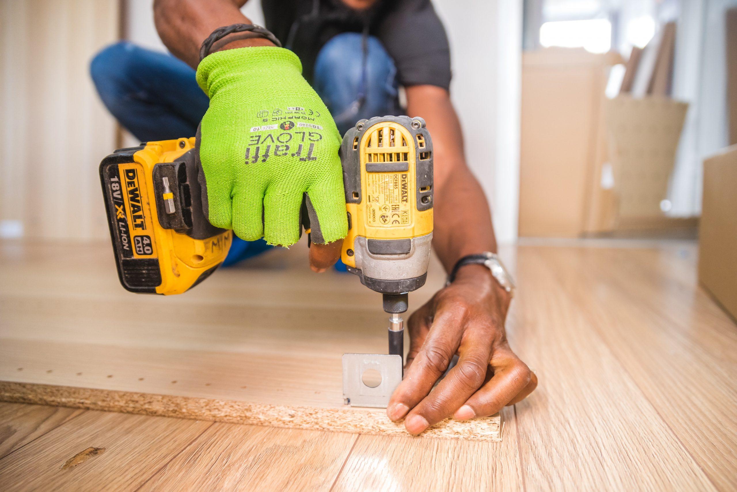 Commercial Handyman Installing Hardware
